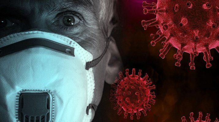 señor con mascarilla y virus